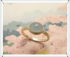 Geelgouden ring met aquamarijn en as