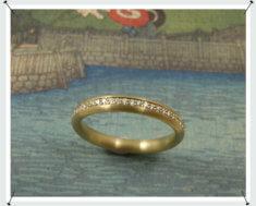 Geelgoud ring diamant in pavé gezet briljant rondom
