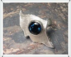 Zilveren ring met ginkgo blad en eigen edelsteen